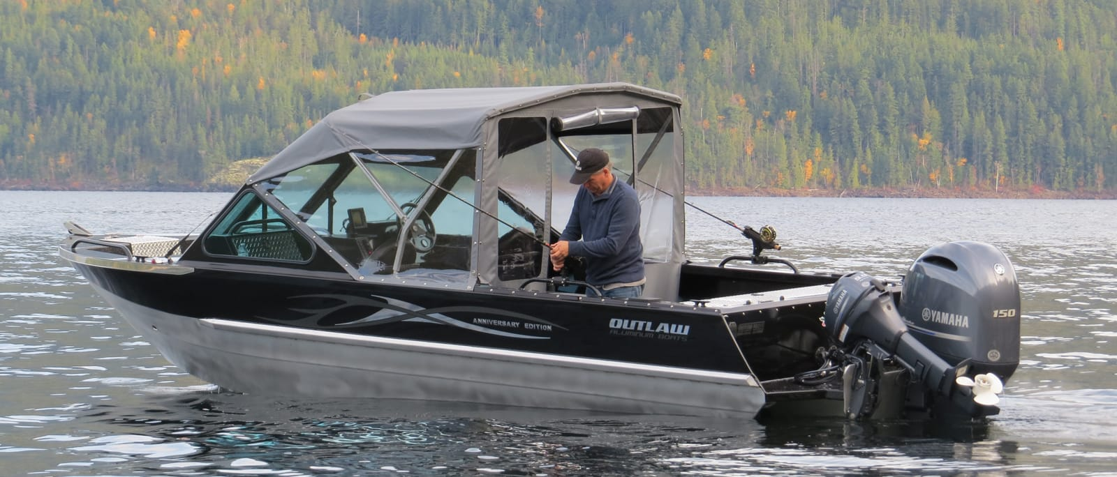 A man driving an outlaw eagle aluminum boat on the water